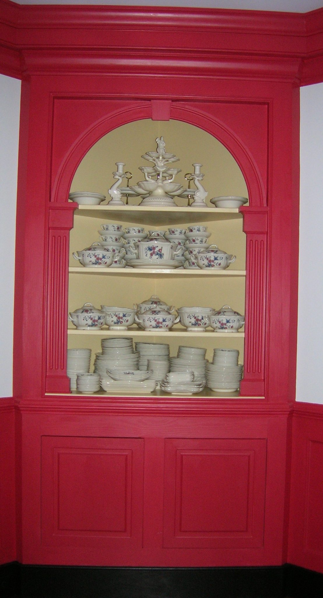 The Large Corner Cabinet Displays An Extensive Collection Of Wedgwood  Queens Ware Tableware And Other Cream Ware Pieces.