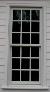 The main house has 9 over 9 double hung windows with bull-nose sills on the first floor.